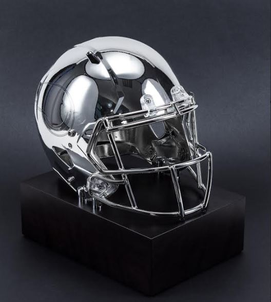 Genuine NFL helmet disassembled and metallised and mounted on a stone base.