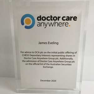 Clear Acrylic block with full colour printed card encapsulated inside it.