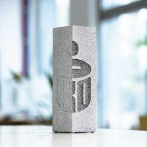 Glass award with concrete style finish